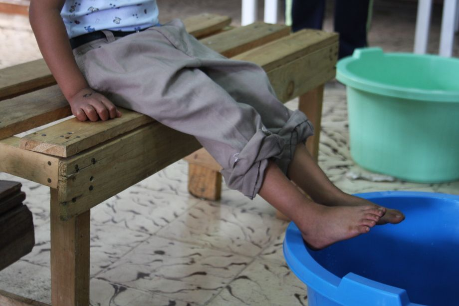 Getting ready to wash this little guy's feet at our shoe distribution.     Costa Rica.    travel4souls.org