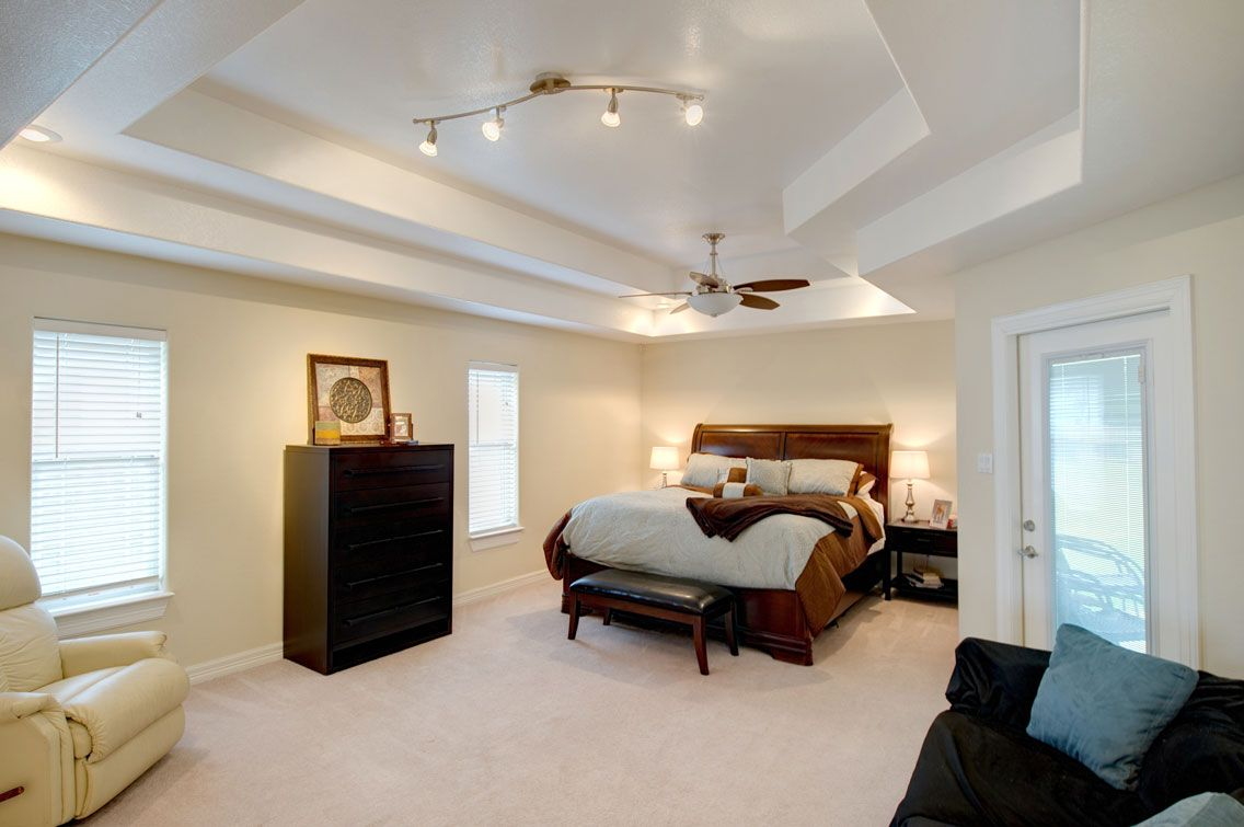 the enormous master bedroom offers a double popup ceiling