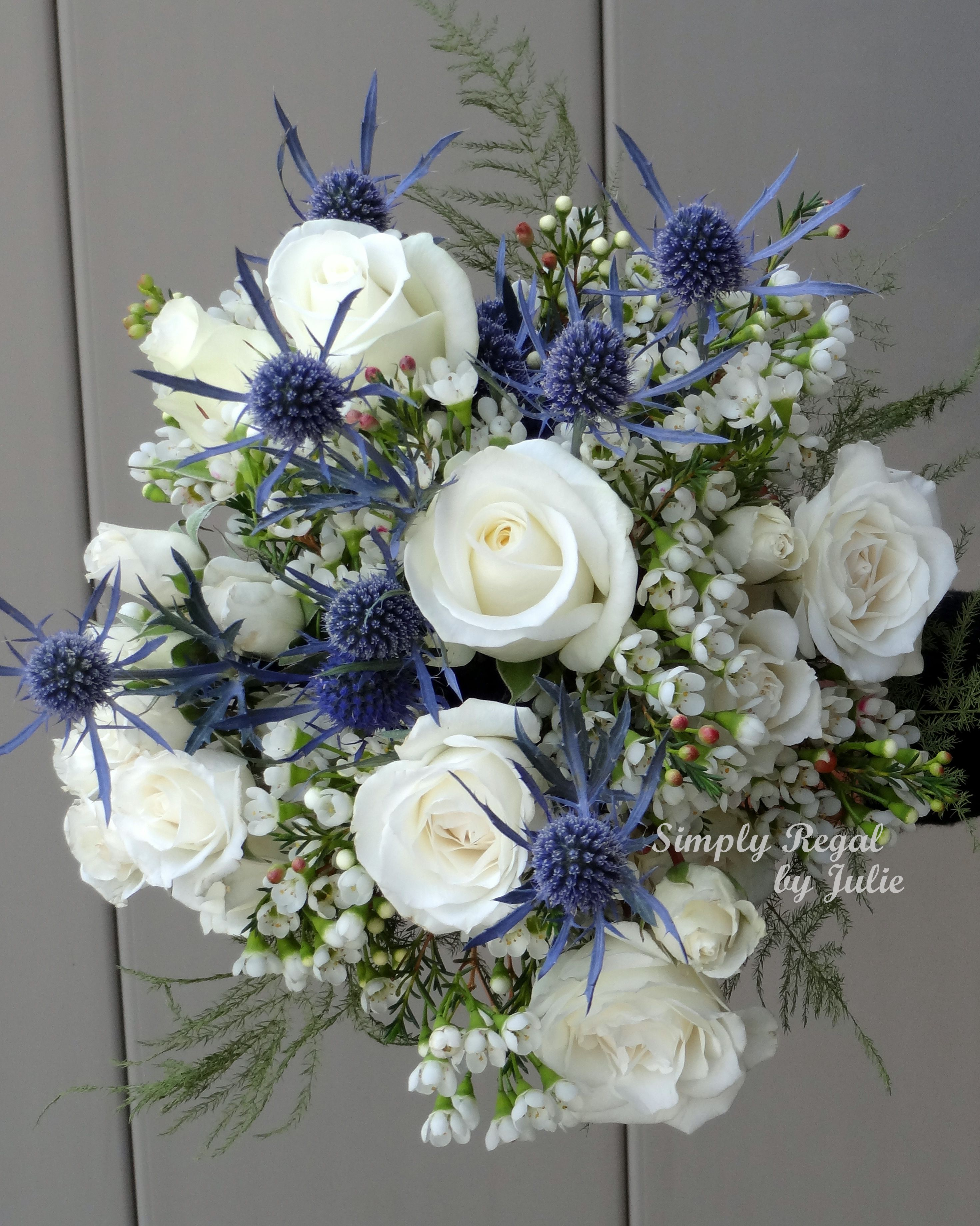 Bouquet with white roses blue thistle and white waxflower bouquet with white roses blue thistle and white waxflower simply regal by julie dhlflorist Image collections