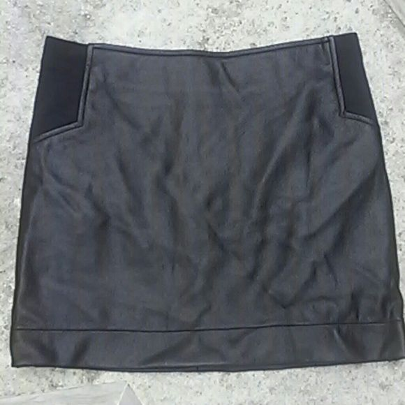 BCBG black skirt This is a beautiful BCBG skirt size XS. Has a stretchy material on the side. Very sexy for a night out with a loved one. :) BCBGMaxAzria Skirts Mini