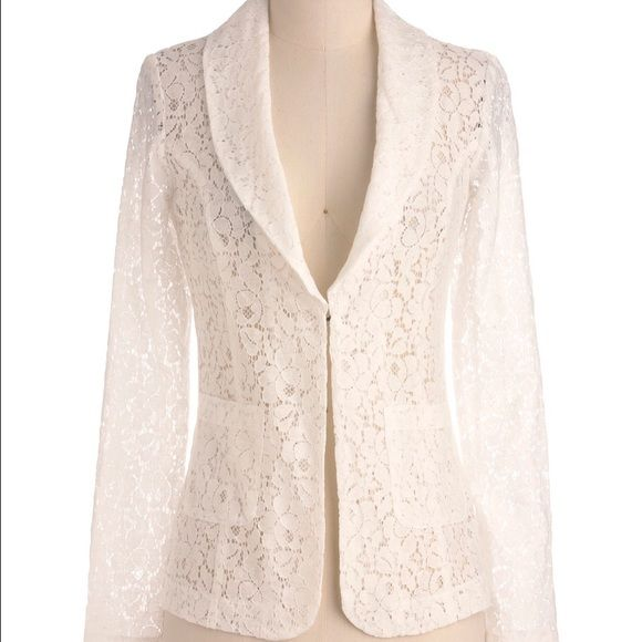 White Lace Jacket by Thread and Supply Unworn. In excellent condition!   Feminine style to complement formal or informal attire. Floral pattern with single hook-and-eye closure provides for understated, sophisticated chic look. Wear this look with a sky-blue, sleeveless shift, kitten-heeled pumps, and demure earrings, and you'll be dressing like a fashion pro! 80% Cotton, 20% Nylon. Fabric does not provide stretch. Dry clean only. Unlined. Sheer. Front hook and eye closure. Pockets at hips…