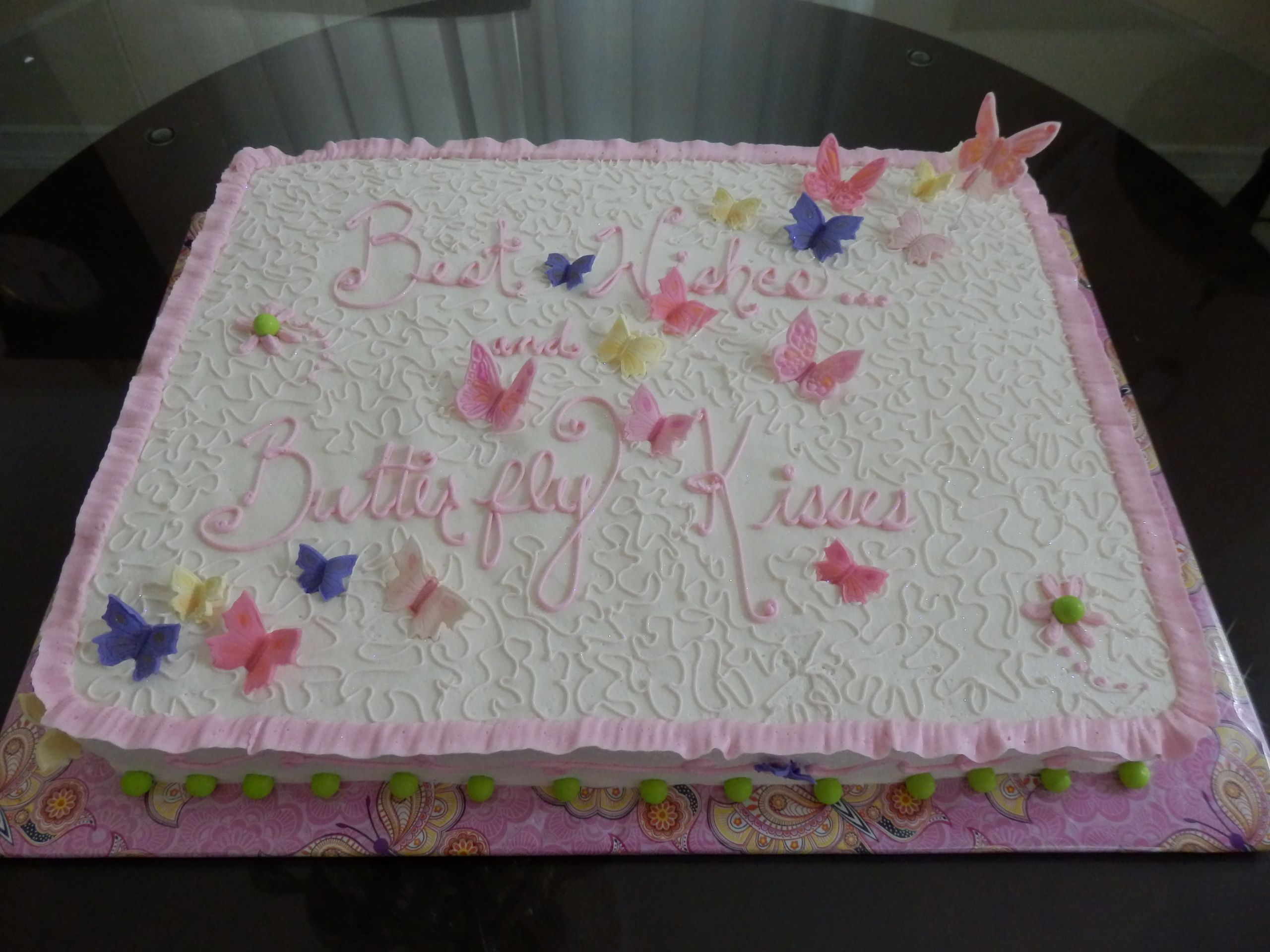 Baby shower cake filled with best wishes and butterfly
