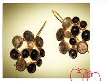 perlas grises, rutilos dorados y oro brillo