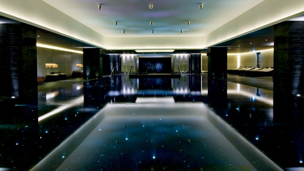 A Black Tiled Pool With Inset Led Lighting This Is An Indoor Pool At The Ritz Carlton