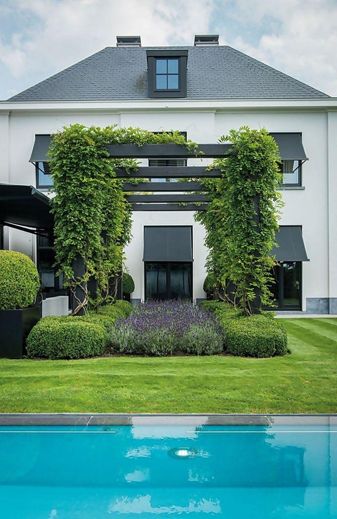 Elegante jardim Belga Elegante, Jardín y Casas