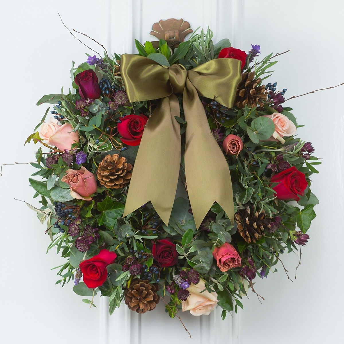 Available for delivery from 1st December 2015  Presenting the breath taking Christmas Red Antique door wreath. A perfect blend of scented roses and seasonal foliage  Order early to avoid disappointment