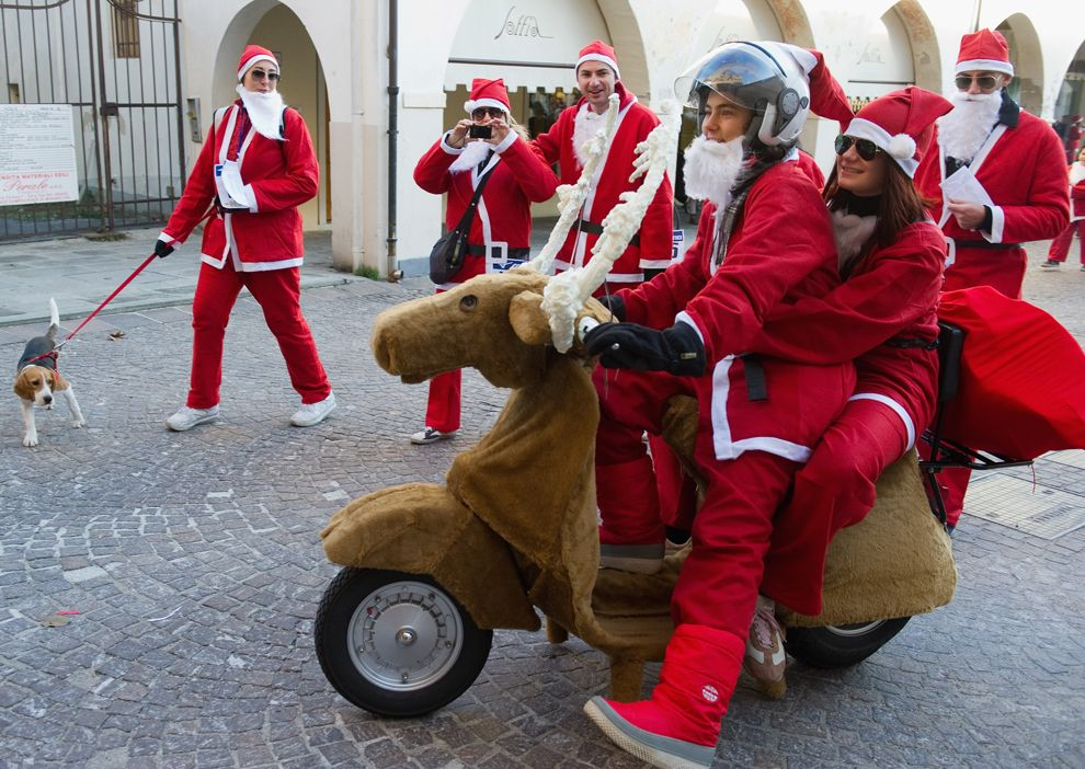 Santa Claus riding a vespa scooter that was turned into a reindeer | Merry Christmas and Happy Holidays