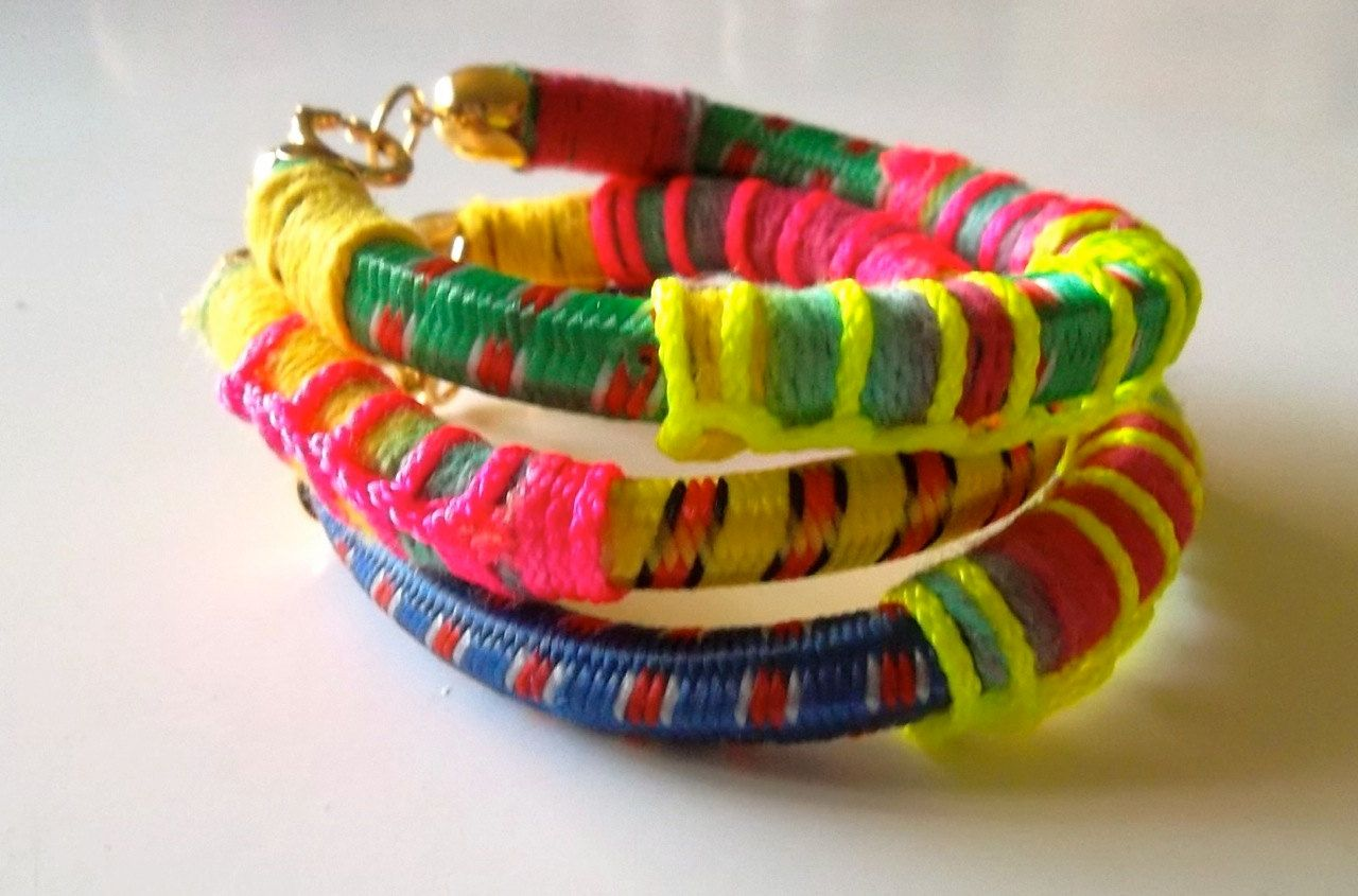 Set of bangles bungee cord bracelets with neon details and gold