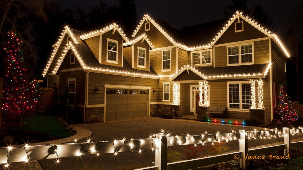clear c9 lights decorate the house while the columns are wrapped in mini clear