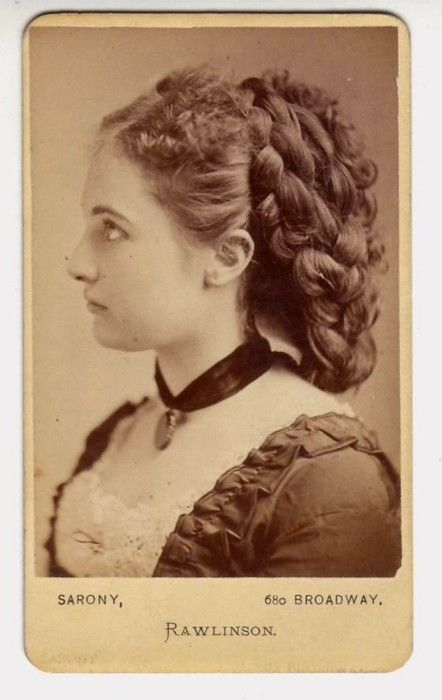 A captivatingly beautiful young Victorian woman sporting a lovely braided hairstyle. #photo #Victorian