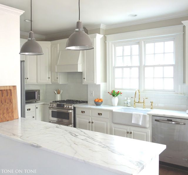 White Cabinets Gray Subway Tile Kashmir White Granite: Honed Calacatta Gold Marble Countertops With White Subway Tiles In An Updated Contemporary Size