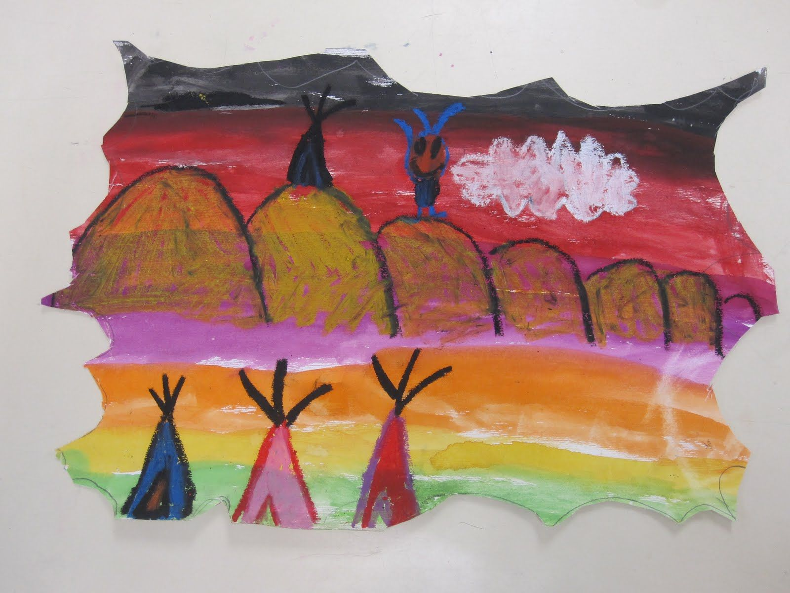 Legend of the Indian Paint Brush- book by Tomie DePaola. 1st grade. Brainstormed images from the story. Painted in a rainbow pattern of stripes. Scalloped the edges to look like animal skins. Oil pastel to draw Native American scenes.