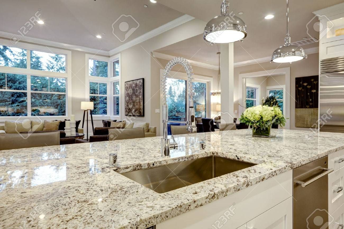White Kitchen Design Features Large Bar Style Kitchen Island With Granite Countertop Cost Of Granite Countertops Kitchen Countertop Trends White Kitchen Design