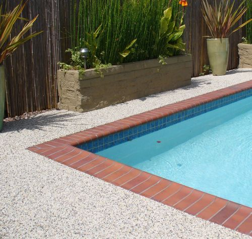 rock and pebble paving system for driveways, patios, and pool