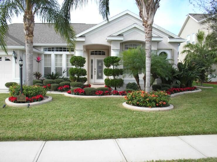 front yard landscape plans with red flowers and trees plus beautiful white house - Residential Landscape Design Ideas
