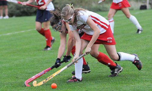A Heated Contest For The Ball Www Findaballer Com Field Hockey Popular Sports Whalers