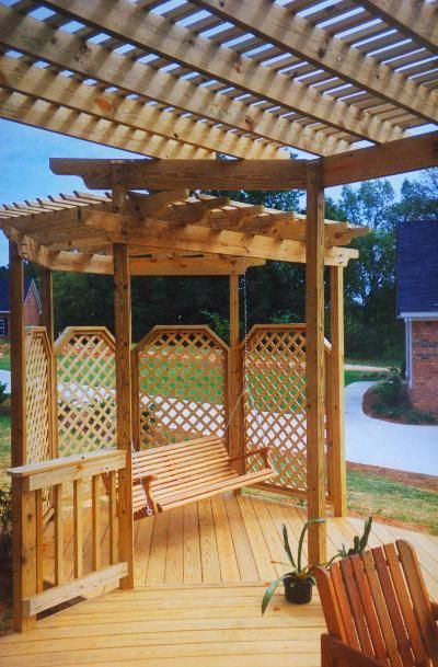 Unique shade/ swing pergola integrated into this wooden