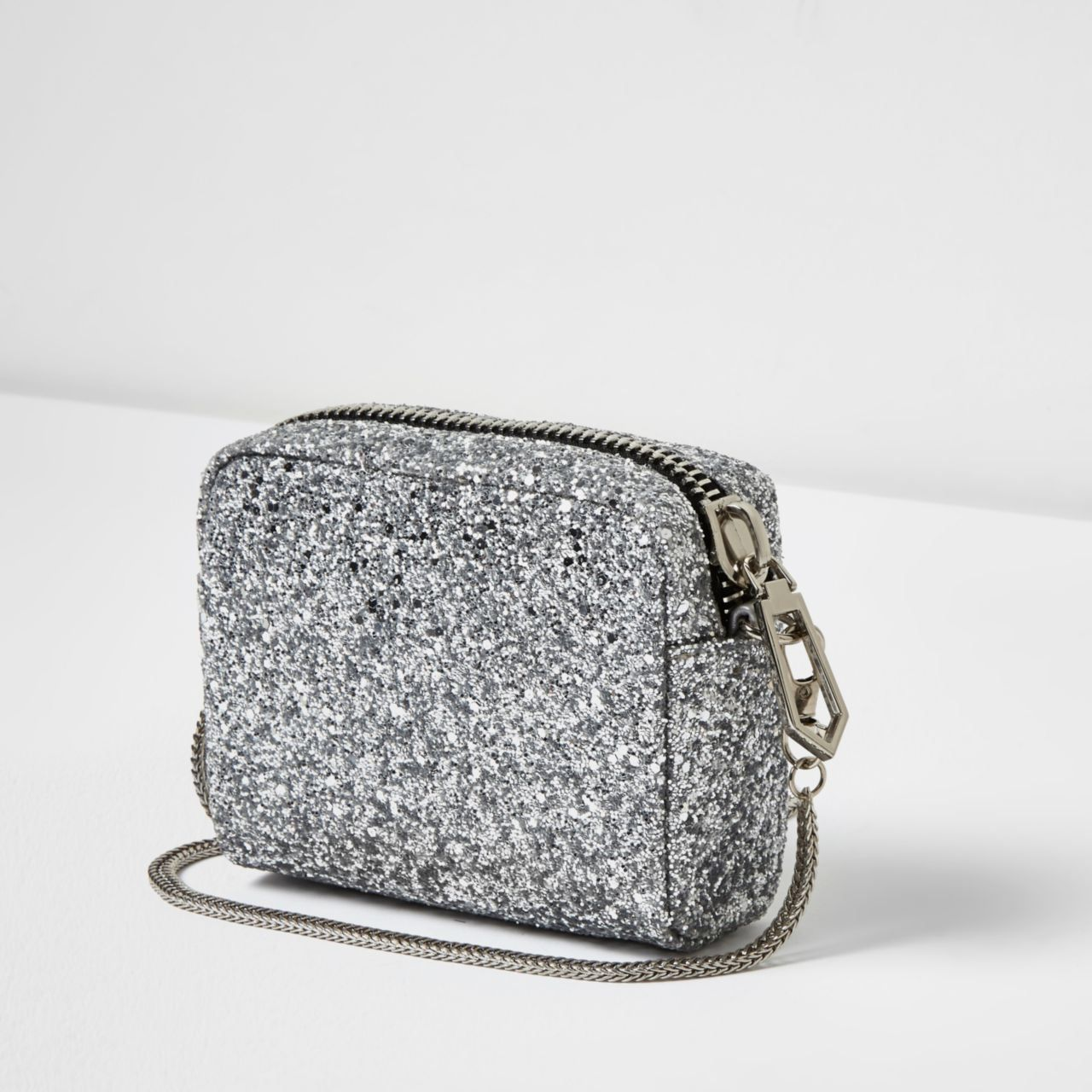 Checkout this Silver glitter mini crossbody bag from River Island