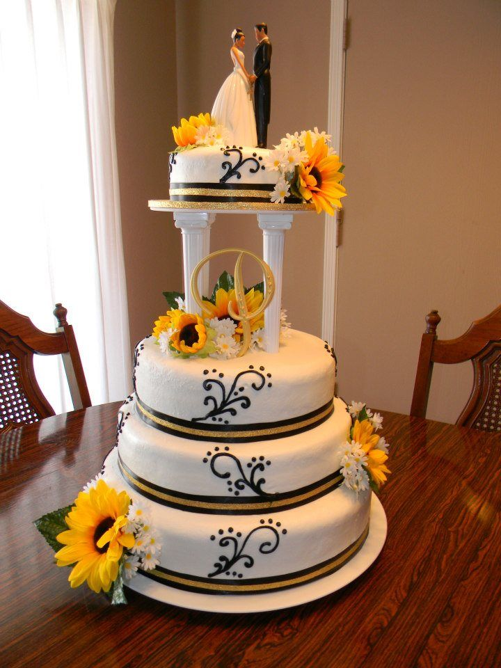 Sunflower wedding cake Miranda wants a cake topper with a