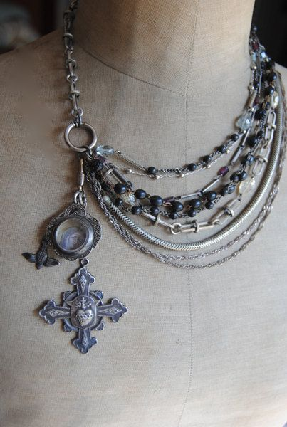 I like the off center dangle on this multiple chain necklace. Shouldn't be too hard to make.