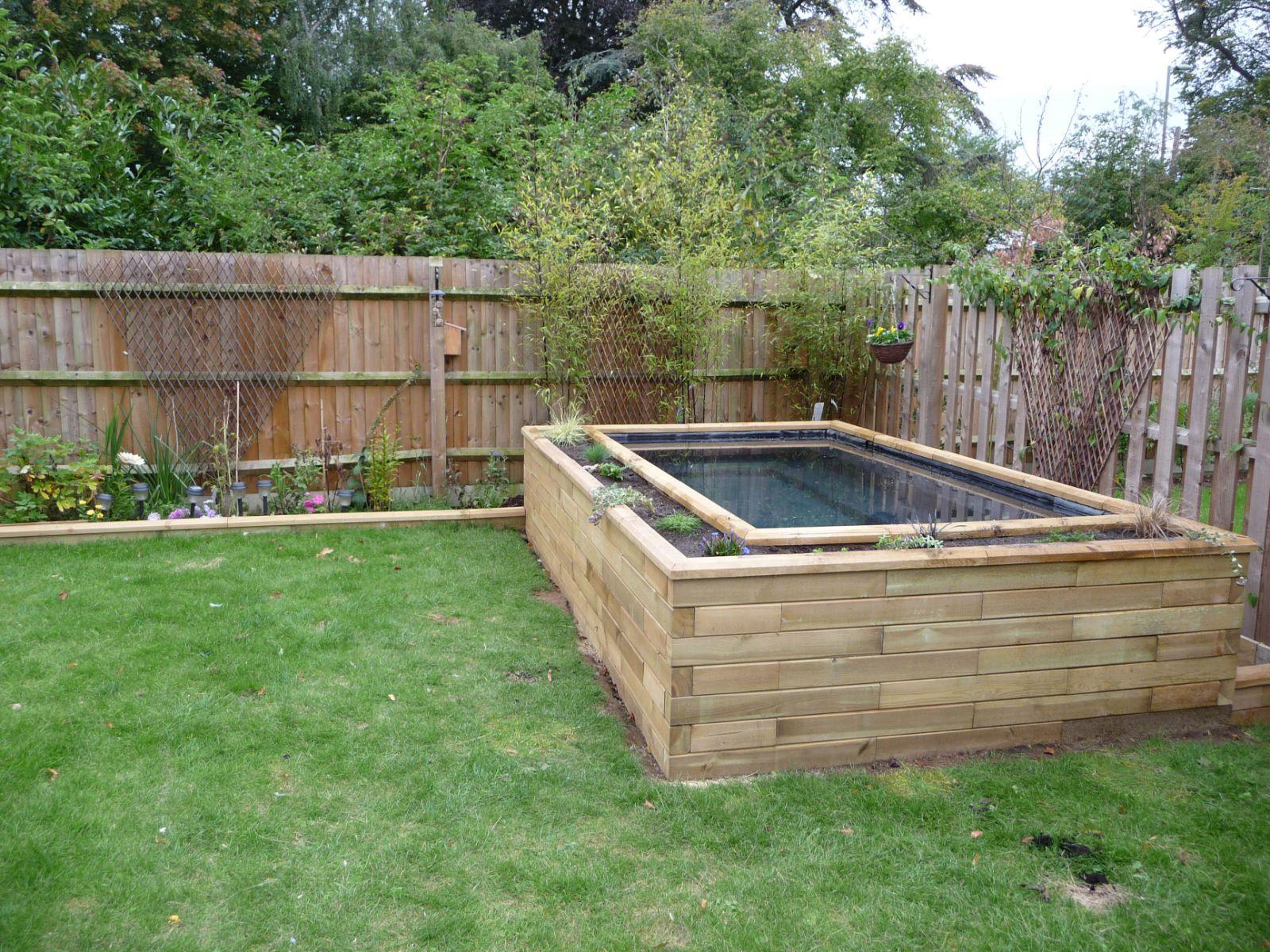 Large raised Koi pond. www.WoodBlocX.co.uk Garden