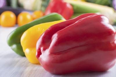 YES! Green, red, yellow and orange peppers are all the same type of pepper left to ripen to different stages. The riper, the sweeter. Green peppers are the youngest type.  33 calories and 7 g carbs. A red bell pepper has 140 mg of vitamin C and 4218 IU vitamin A, making it an immunity system powerhouse. When eating bell peppers raw, you don't lose any of the essential and beneficial nutrients during the cooking process.