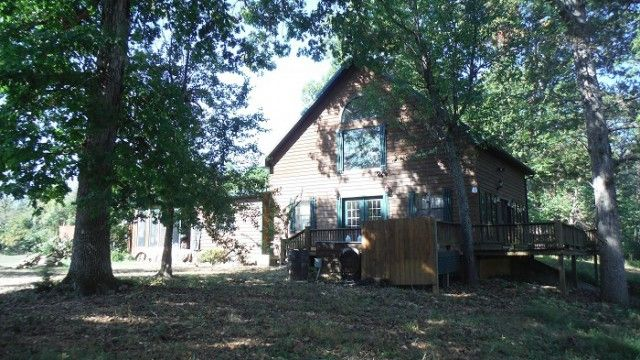 A very nice find in the southeast Missouri Ozarks, A 3 Bedroom, 3 Baths rustic style home. This beauty offers a den, familyroom, open livingroom/diningroom ,C/H/A, new granite counter tops in kitchen, ample windows,sun porch, partial basement , custom tile work throughout the home, large wrap around deck with hot tub and pool. Also offered outside is fruit trees, property borders creek , barn with corral , corners Mark Twain Forest and is only 3.5 miles to public access in Doniphan MO