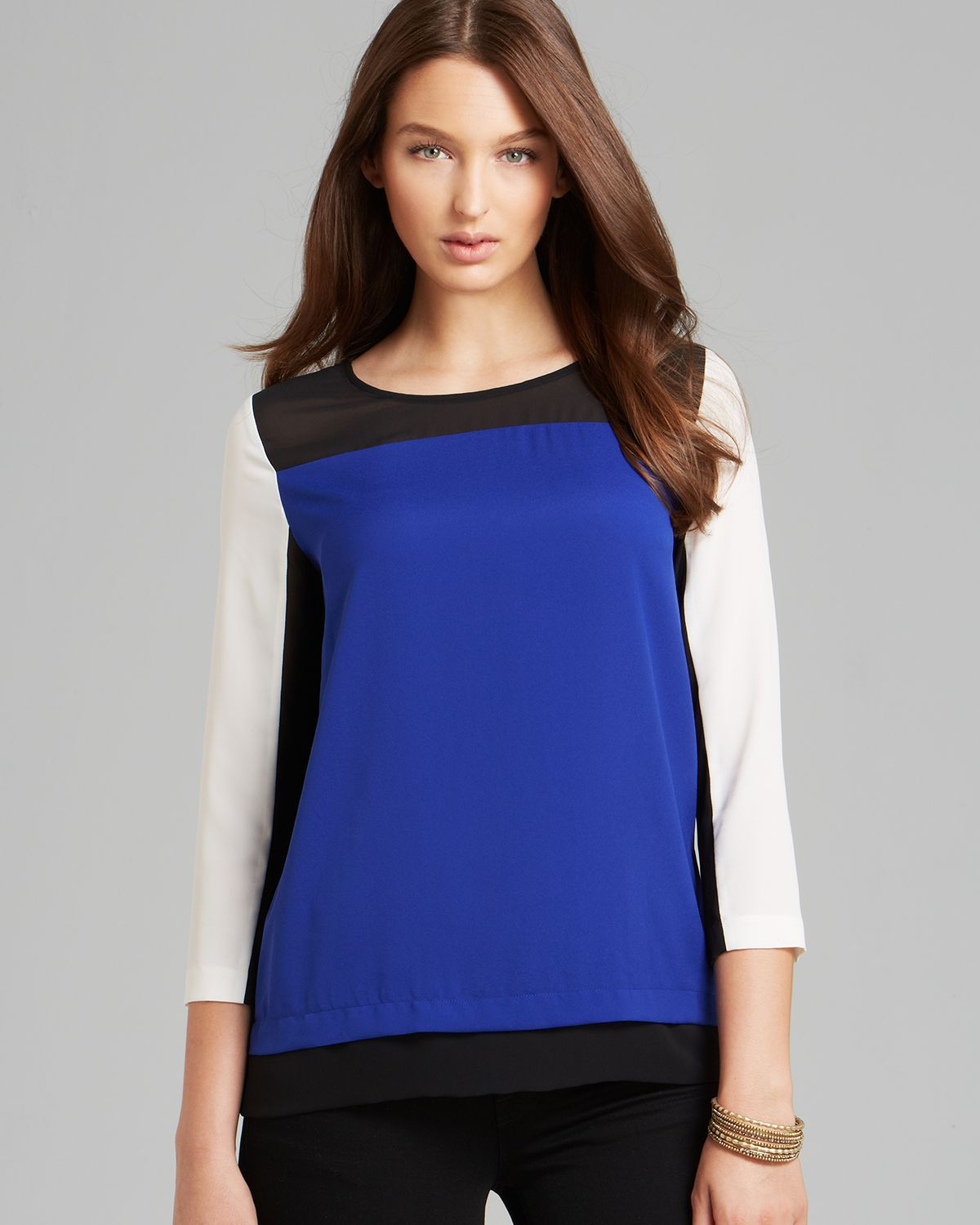 http://www.lyst.com/clothing/dkny-three-quarter-sleeve-color-block-blouse-lapis/?product-gallery=19583856