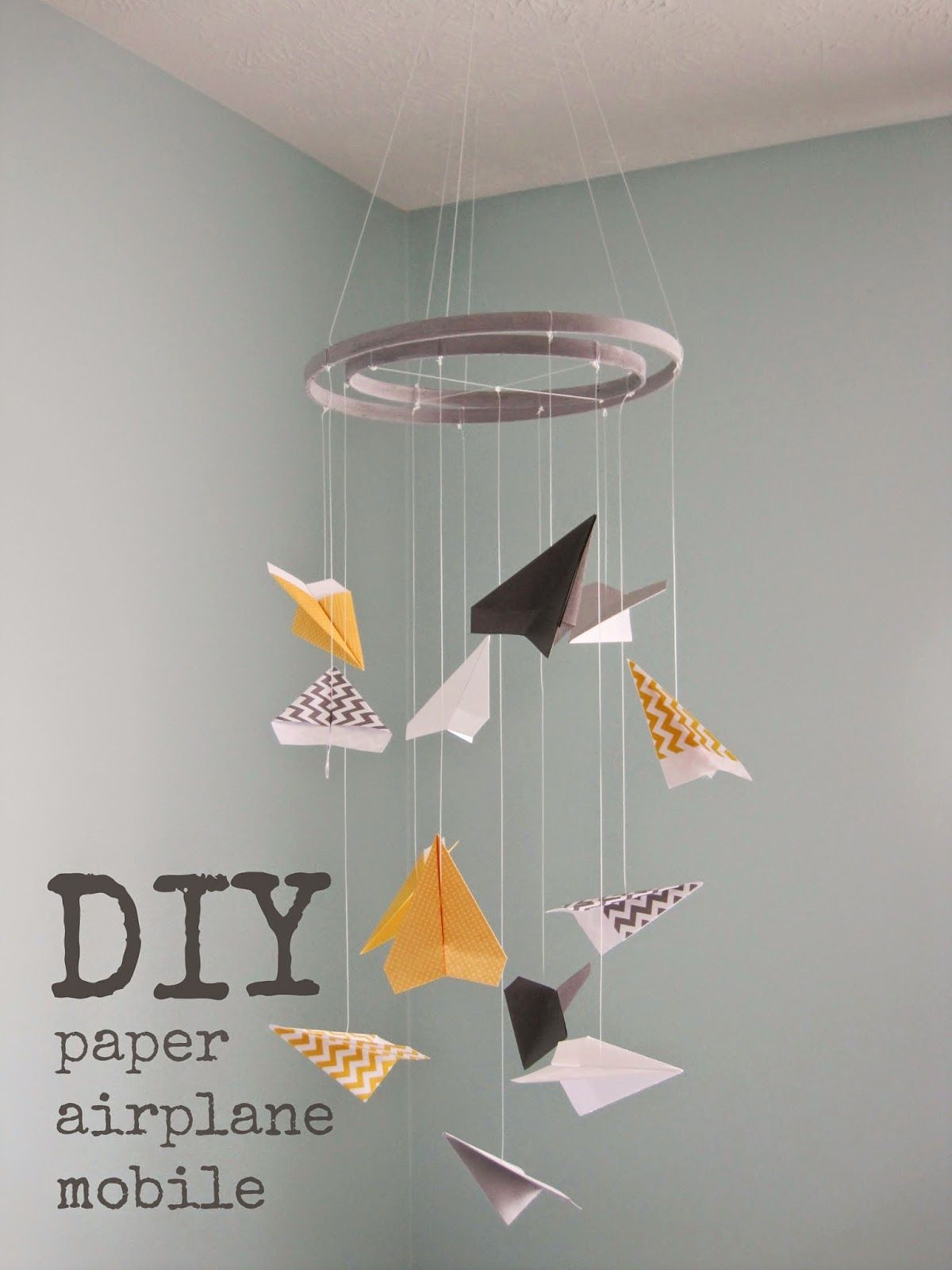 paper airplane mobile tutorial from knee deep in the baby pool interiors big boy room. Black Bedroom Furniture Sets. Home Design Ideas