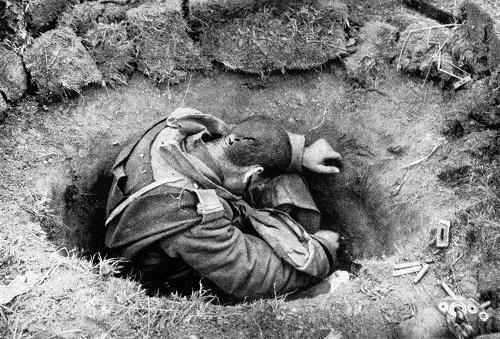 Romanian soldier killed in his foxhole after receiving a piece of shrapnel in the back of his head.
