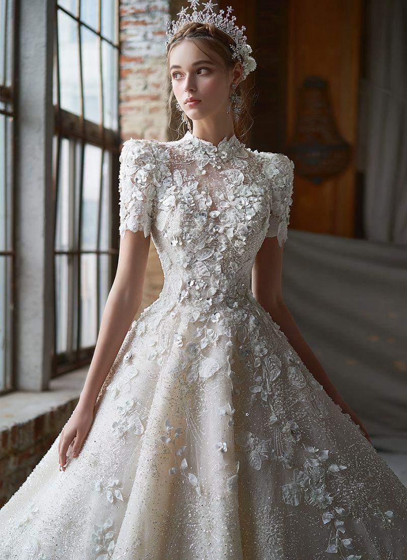15 Ethereal Flower-Inspired Wedding Dresses For Your White Garden Wedding