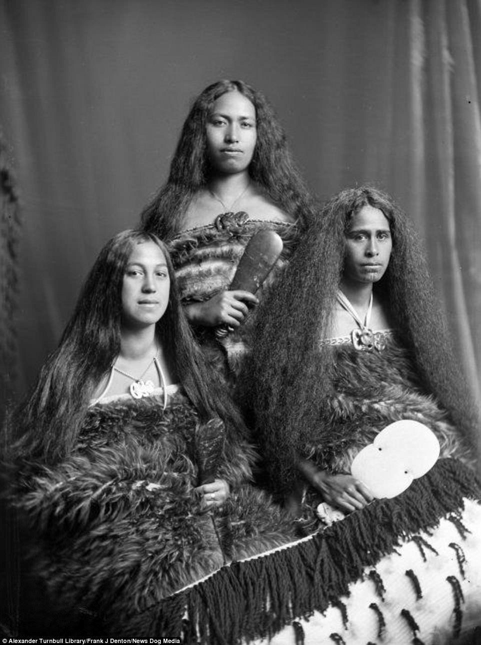 83456263f These long-haired Maori women are wearing Maori kiwi cloaks, tiki  (greenstone ornaments