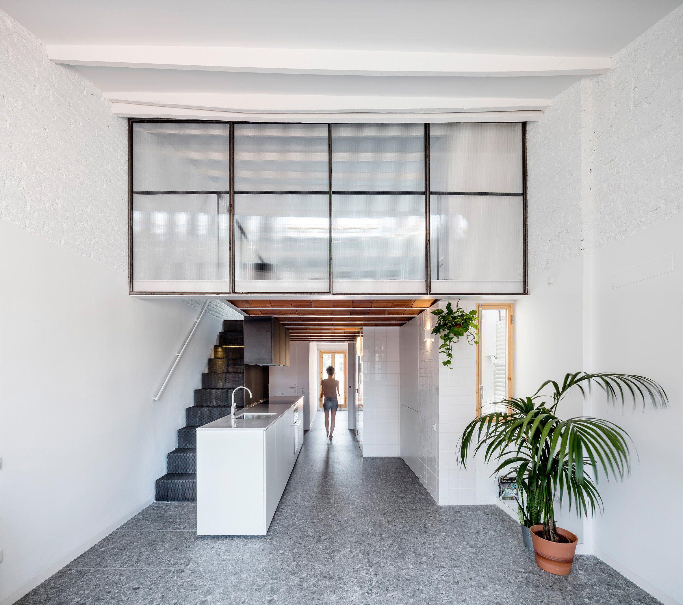 Ras Studio has overhauled a loft apartment in Barcelona creating a