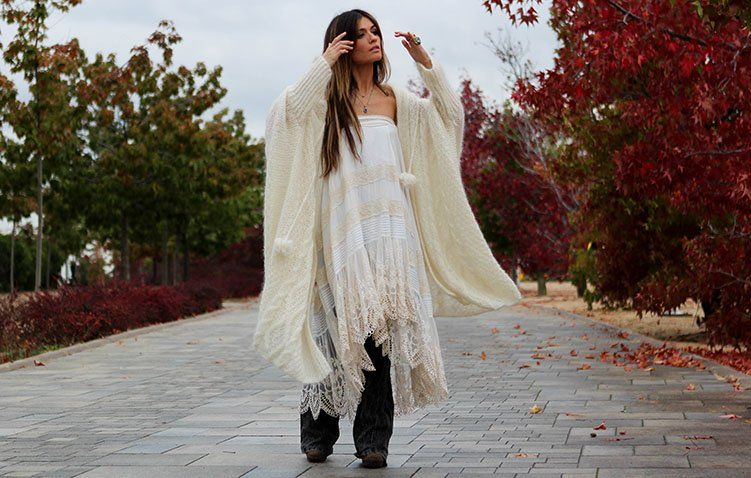 I love this sweater cape and have it in another color... #boho #freepeople