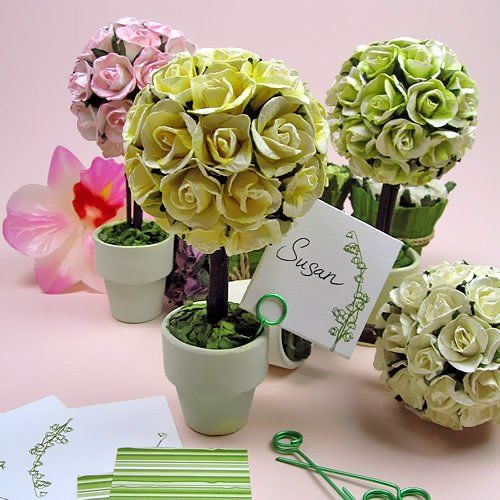 Mini rose topiaries are beautiful table decorations and party favors for weddings and bridal showers topiaries can double as place card holders and are