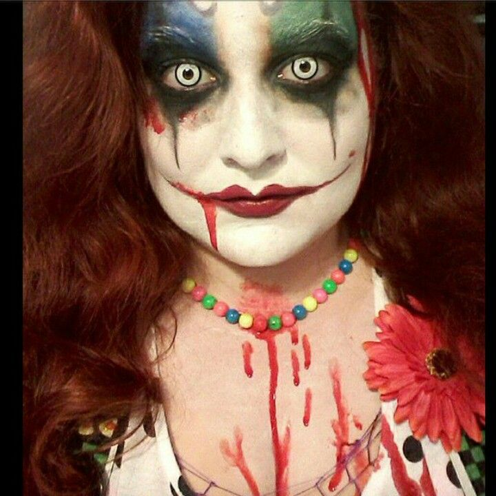 Creepy eyes scary clown Halloween makeup with blood and scary ...