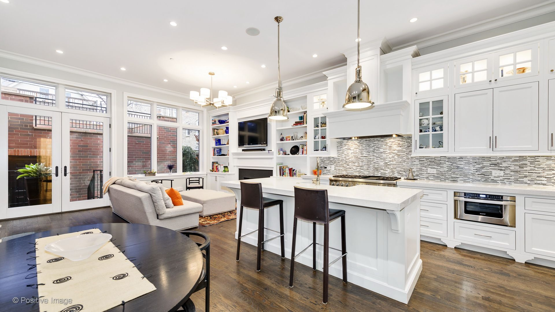 Modern Open Concept Kitchen And Living Area With Hardwood Floors Pendant Lighting Recessed Dark Wood Dining Chair Apartments For Rent Round Wood Dining Table