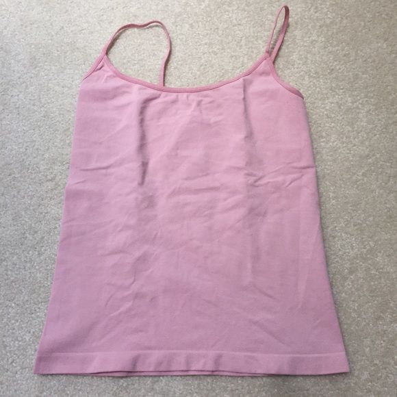 Bebe seamless layering camisole Bebe seamless layering camisole. Tags cut out. Will fit XS or S. Gently used. bebe Tops Camisoles