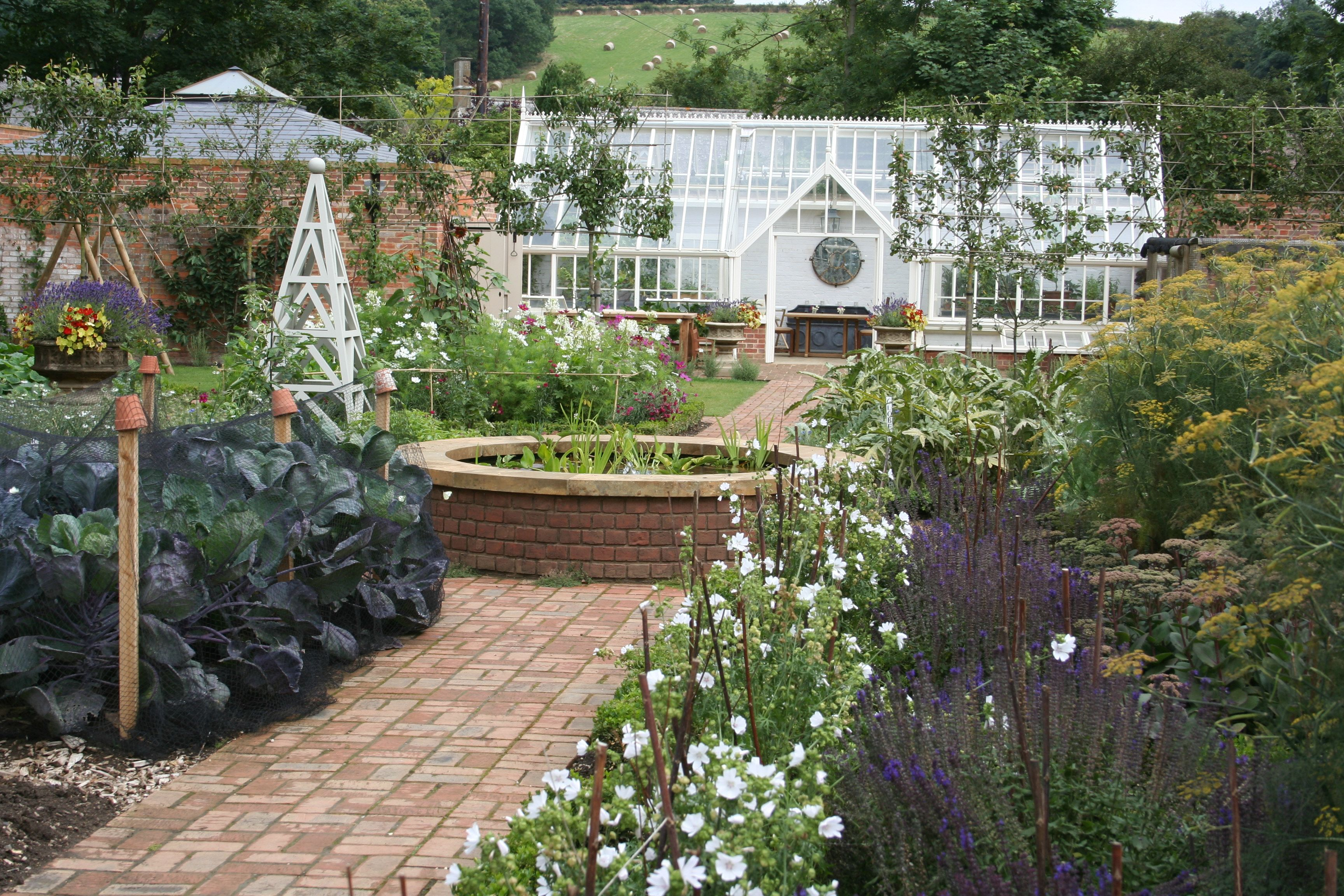 A bespoke greenhouse in a new walled garden. Wonderful dining room in the central area of the greenhouse too.