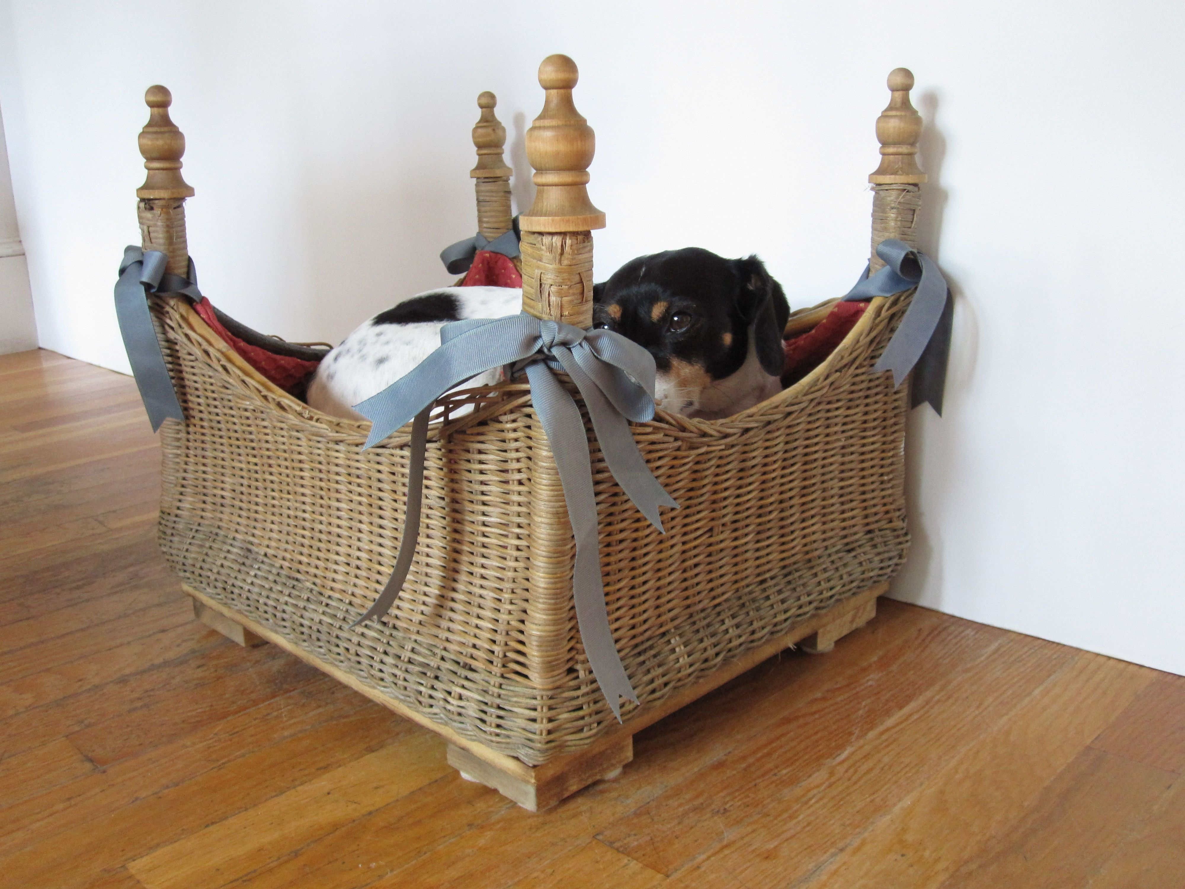 Dog bed I made from a foot stool. Curtain finials for