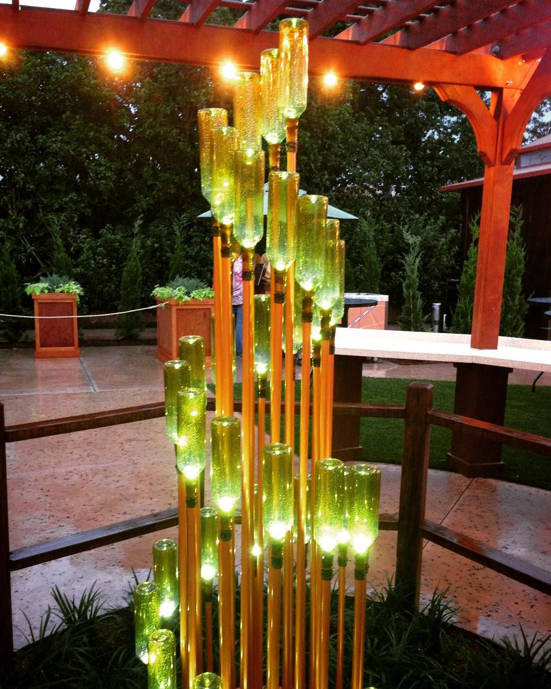 Spotted this gorgeous light fixture at epcot its just green wine jen yates on instagram spotted this gorgeous light fixture at epcot its just green wine bottles copper painted pvc pipe so great diy potential arubaitofo Image collections
