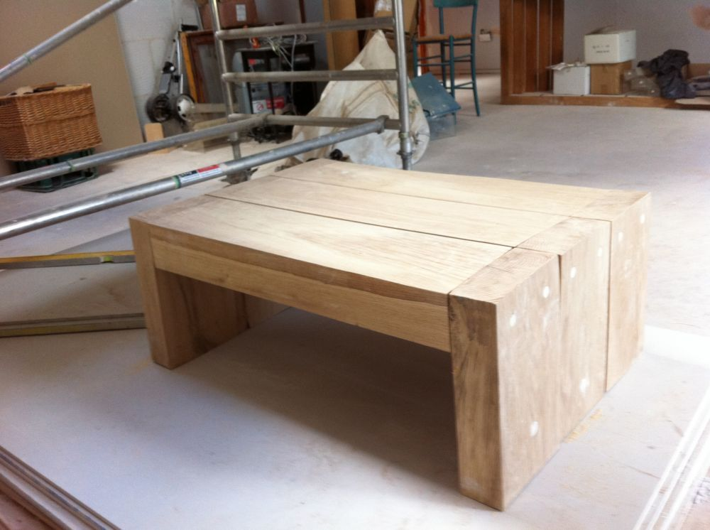 a simple coffee table made from new oak railway sleepers | indoor