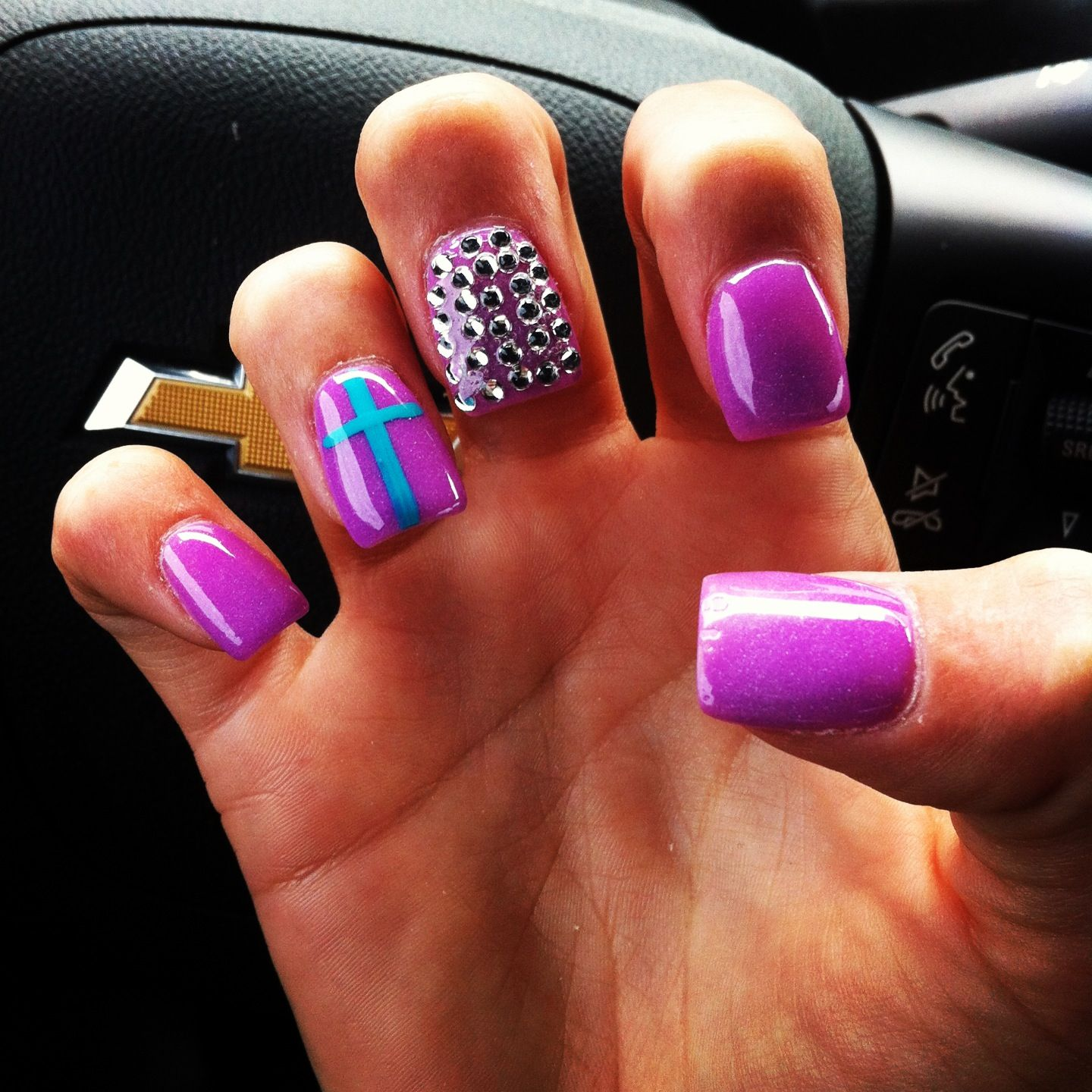 Purple powder fake nails with rhinestones and turquoise cross design ...