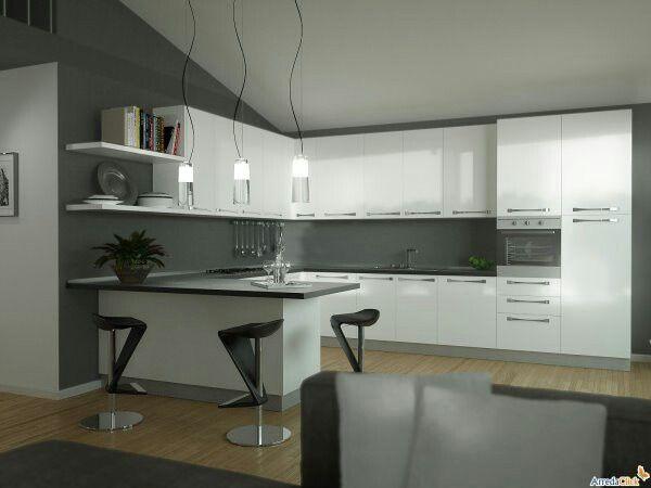 cucina con penisola bianca con top nero