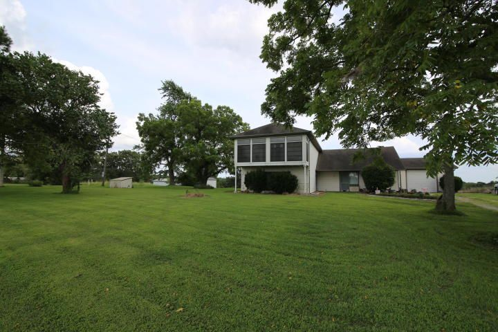 Charming Country Home in the Ozarks! 3BD/2BA home with outbuildings, barn, pond and fenced for a few animals! So much potential with this quaint property. Garden area includes Apple and Peach trees. Located north of Mountain Grove,MO on paved road. LOCATION-LOCATION-LOCATION!