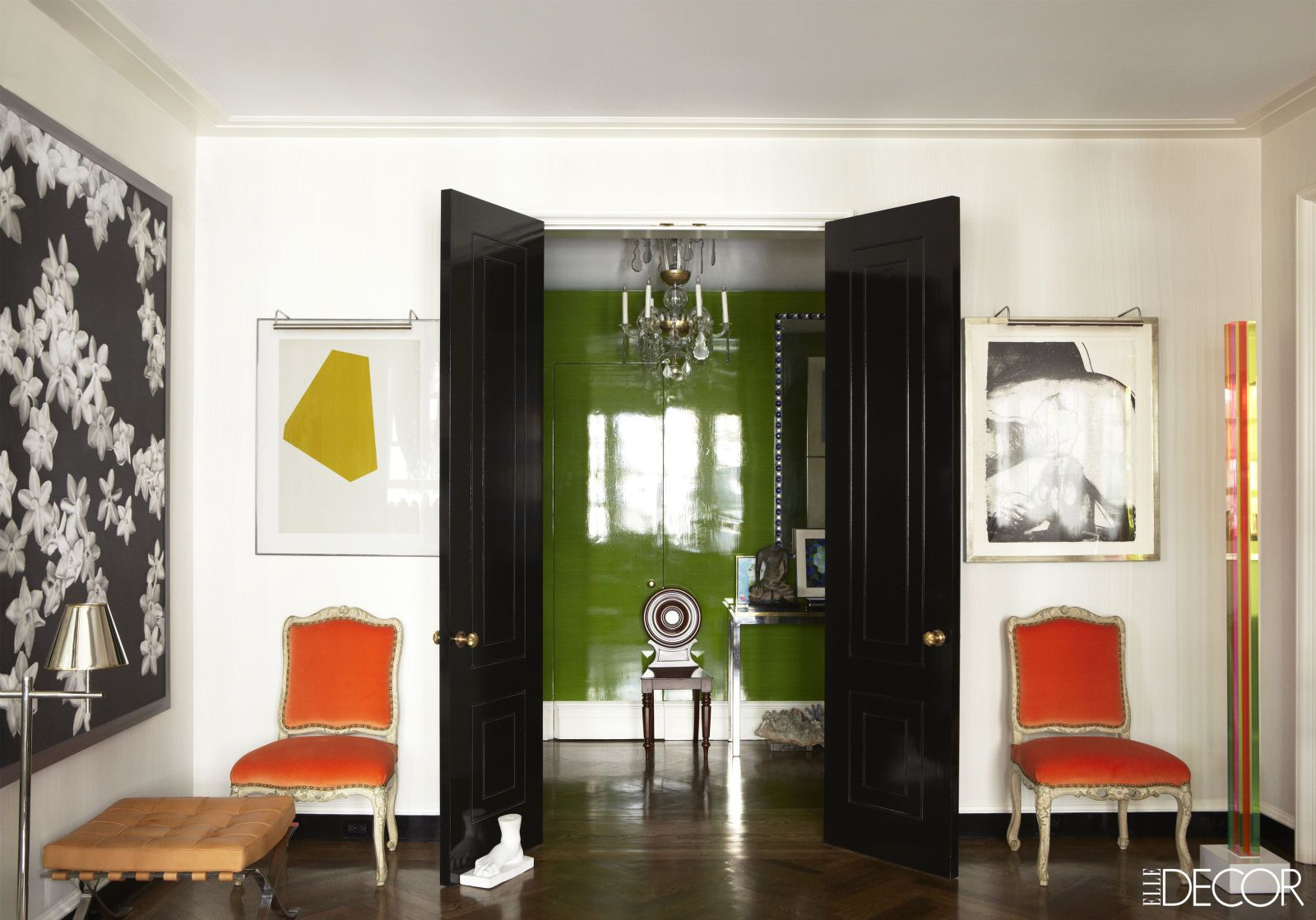In decorator Todd Alexander Romano's Manhattan apartment, this living space opens up onto a lacquered green entrance hall featuring a Regency mahogany chair.   - ELLEDecor.com