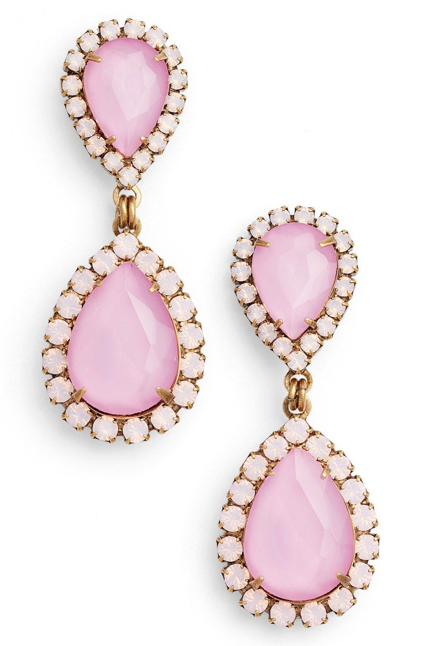 d0488b121 Shimmering halos of smaller stones enhance the dazzling sparkle of faceted,  teardrop-shaped crystals in pale pink making these chic statement earrings  an ...