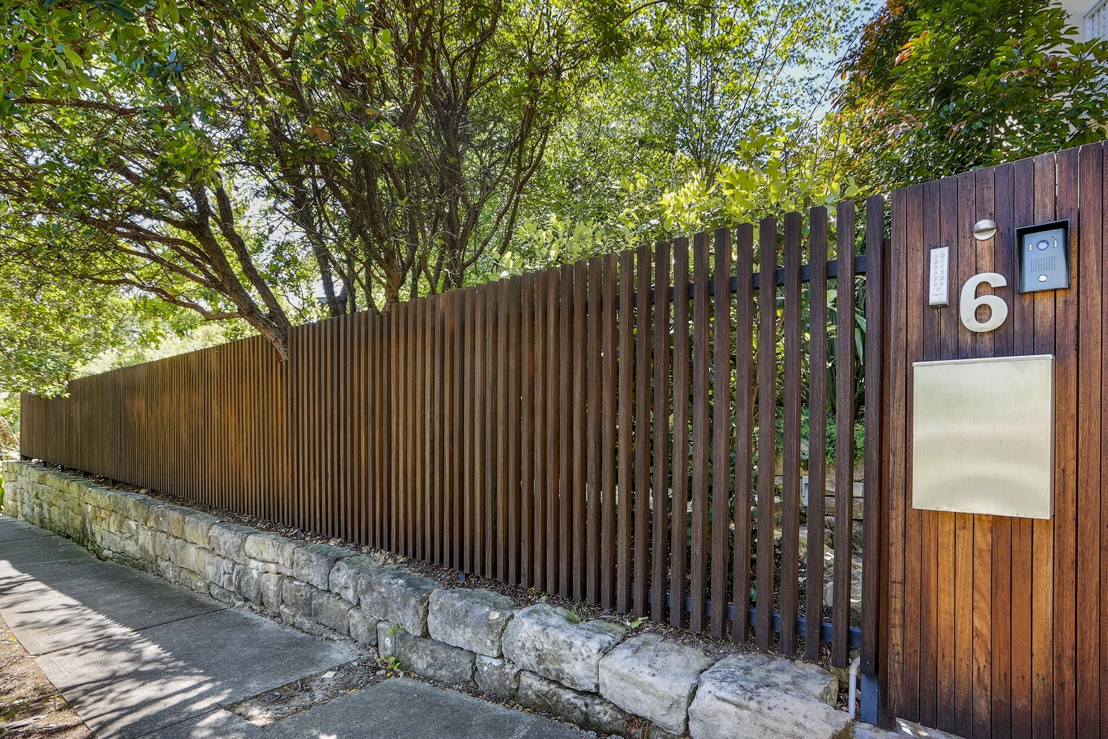 Timber batten front entry fence formed gardens fence for Front garden fence designs