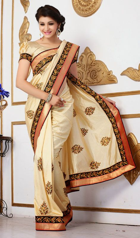 bf7dd2d7fbb81 Cream Embroidered Raw Silk Saree Look dazzling draped in this cream  embroidered raw silk saree. Beautified with lace and resham work.