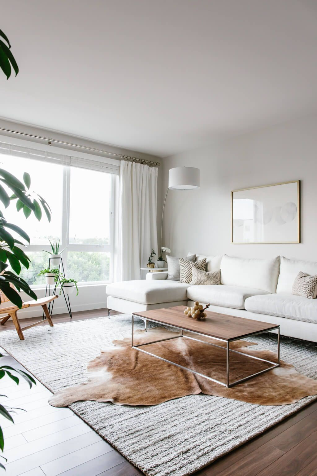 Take a tour of my modern and minimalist living room my interior design style is a blend of minimalism mid century modern scandinavian and socal vibes